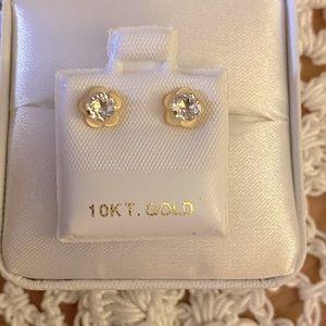 10k yellow gold white topaz earrings.